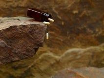 Antibiotics Falling off the Cliff Edge royalty free stock image