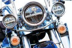 Antibrouillards et phare de moto sur un fond blanc images stock