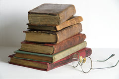 Antic books 1. Pile of old antic books with eyeglasses Royalty Free Stock Photography