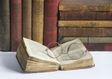 Antic books 1. Pile of old antic books with eyeglasses Royalty Free Stock Image