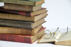 Antic books 3. Pile of old antic books with eyeglasses Stock Image