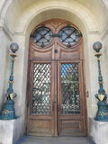Antic door. Antic wood door with two rosette Stock Images