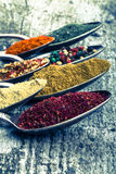 Antic metal spoons with different kinds of spices on old wooden Stock Photography