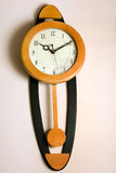 Antic Pendulum Wall Clock Stock Image