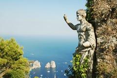 Capri island. Antic statue pointing Capri island, Italy royalty free stock photography