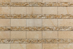 Antic tile. The close up of the wall with vintage beige tile Stock Photo