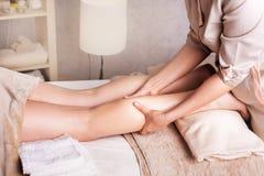 Anticellulite leg massage. Woman having anticellulite foot massage. Spa Salon therapeutic foot massage stock images