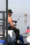 Anticipation. An angler practicing his favorite past time Royalty Free Stock Image