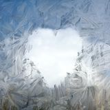 Anticipation of the day of lovers. Heart sign thawn on a frozen window Stock Image