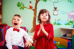 In anticipation of the holidays. cute gentleman in wheelchair and lady in rehabilitation center for kids with special needs Royalty Free Stock Photography