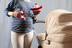 In anticipation of motherhood. Pregnant belly Stock Photos