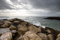 In anticipation of the storm. Dramatic sky on the stone coast of Royalty Free Stock Photo