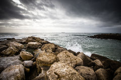 In anticipation of the storm. Dramatic sky on the stone coast of Stock Images