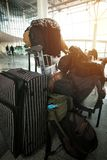 In anticipation of travel. Man who has a lot of bags, sits waiting for an airplane at the airport Stock Image