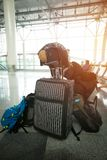 In anticipation of travel. Man who has a lot of bags, sits waiting for an airplane at the airport Stock Photography