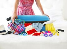 Clothes and accessories in turquoise suitcase. Anticipation of voyage. Clothes and accessories in turquoise suitcase Royalty Free Stock Photo