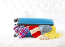 Clothes and accessories in turquoise suitcase. Anticipation of voyage. Clothes and accessories in turquoise suitcase Royalty Free Stock Photography