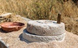 Antico greco, di pietra, mulino del grano della mano Fotografia Stock Libera da Diritti