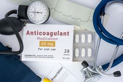 Anticoagulant drug for blood, for prevention or prophylaxis of vascular diseases of heart or brain. Packing of pills with inscript. Ion `Anticoagulant Medication royalty free stock photography