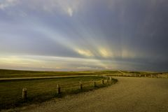 Anticrepuscular rays in the Badlands. Of South Dakota near sunset Royalty Free Stock Photo