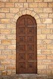 Antieke houten ingangsdeur stock foto