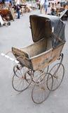 Antieke kinderwagen Stock Afbeelding