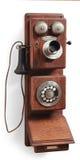 Antieke roterende wijzerplaattelefoon op wit royalty-vrije stock afbeeldingen