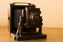 Antieke vouwende plaatcamera Stock Afbeelding
