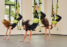 Antigravity yoga exercise indoor Stock Photography