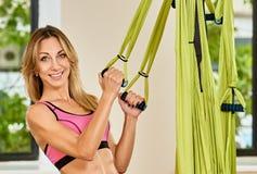 Antigravity yoga trainer Stock Images