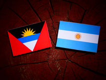 Antigua and Barbuda flag with Argentinian flag on a tree stump i Royalty Free Stock Photos