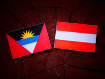 Antigua and Barbuda flag with Austrian flag on a tree stump isol Royalty Free Stock Image