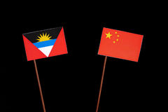 Antigua and Barbuda flag with Chinese flag isolated on black Stock Photography