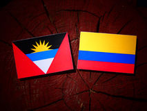 Antigua and Barbuda flag with Colombian flag on a tree stump iso Stock Photos
