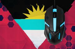 Antigua and Barbuda flag and computer mouse. Concept of country representing e-sports team royalty free stock photo