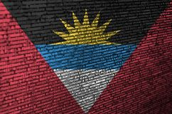 Antigua and Barbuda flag is depicted on the screen with the program code. The concept of modern technology and site development.  stock image