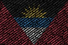 Antigua and Barbuda flag is depicted on the screen with the program code. The concept of modern technology and site development.  stock photo