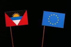 Antigua and Barbuda flag with European Union EU flag isolated on black. Background Royalty Free Stock Photography