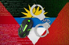 Antigua and Barbuda flag and handcuffed computer mouse. Combating computer crime, hackers and piracy stock image