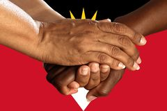Antigua and Barbuda flag, intergration of a multicultural group of young people.  royalty free stock images