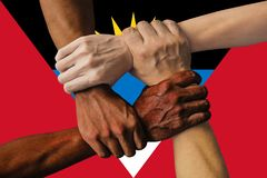 Antigua and Barbuda flag, intergration of a multicultural group of young people.  royalty free stock photography