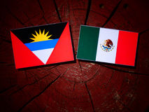 Antigua and Barbuda flag with Mexican flag on a tree stump isola Royalty Free Stock Images