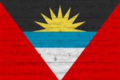Antigua and Barbuda flag painted on old wood plank. Patriotic background. National flag of Antigua and Barbuda stock photos