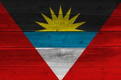 Antigua and Barbuda flag painted on old wood plank. Patriotic background. National flag of Antigua and Barbuda royalty free stock photo