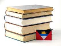 Antigua and Barbuda flag with pile of books isolated on white ba. Ckground Stock Photos