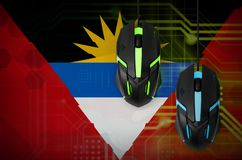Antigua and Barbuda flag and two mice with backlight. Online cooperative games. Cyber sport team stock photos