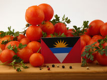 Antigua and Barbuda flag on a wooden panel with tomatoes isolate. D on a white background Stock Image