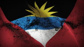 Antigua and Barbuda grunge dirty flag waving on wind. Antigua and Barbuda background fullscreen grease flag blowing on wind. Realistic filth fabric texture on Stock Image