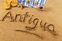 Antigua beach. The word Antigua written on a sandy beach, with scuba mask, beach towel, starfish and flip flops stock photo