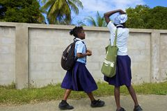 Antigua, Caribbean. Children coming back from school in Antigua, Caribbean stock photo